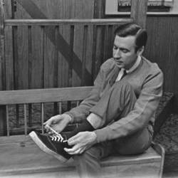 Mr. Rogers putting on his shoes